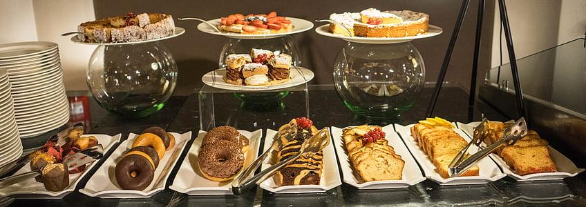 varieties of food on plates and trays on display