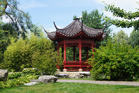 architectural photography of red gazebo