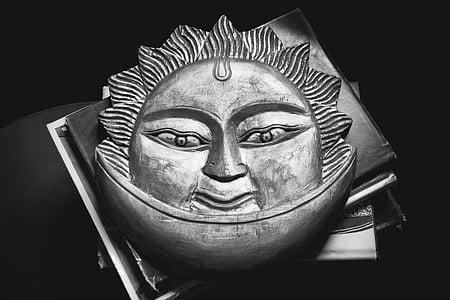 celestial sun carved artwork