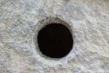 gray concrete surface with hole