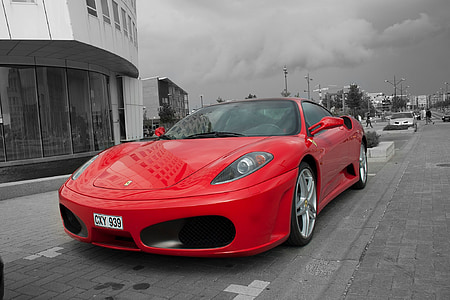 selective color photography of red Ferrari sports coupe