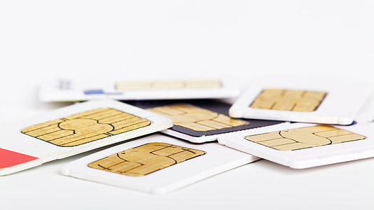assorted sim cards on white surface