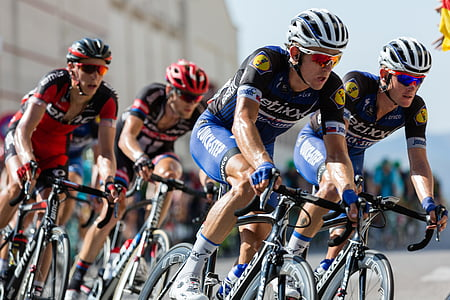 photo of bicycle racer during daytime
