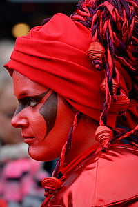 closeup photography of woman wearing red and black headdress