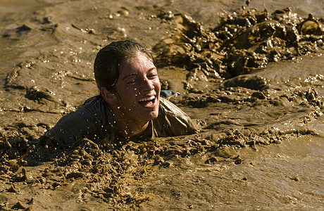 person submerged in mud