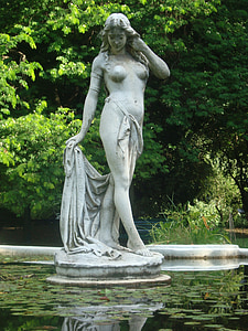 topless woman holding textile statue