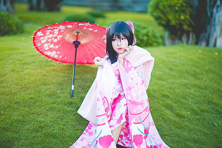 woman wears pink and white floral kimono