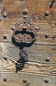 photo of brown steel handle