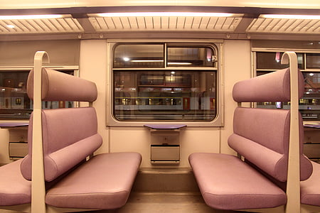 pink leather padded train seat