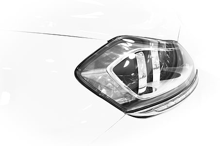 closeup photography of vehicle headlight