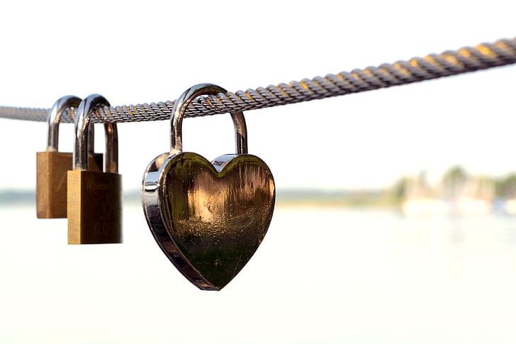 heart-shaped padlock locked on rope
