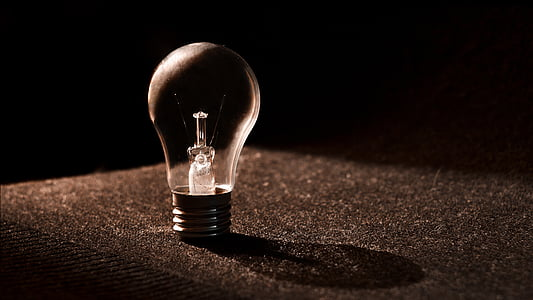 LED bulb on black surface