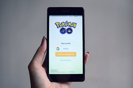 person holds smartphone with Pokemon Go application running