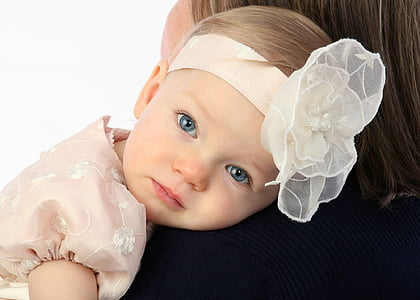 closeup photography of woman carrying baby
