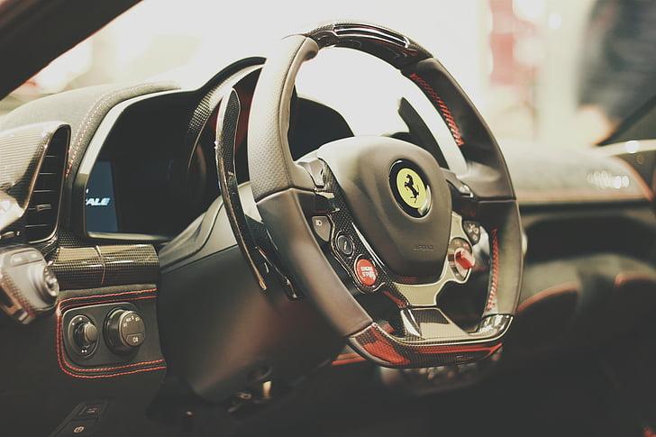 closeup photo of Ferrrari steering wheel