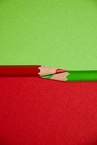 two red and green colored pencils