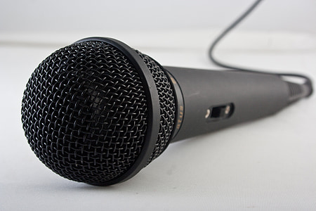 black and gray corded microphone on white surface