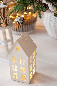 white house lantern candle holder on focus photo