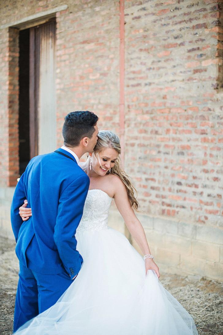 Royalty-Free photo: Woman wearing white bridal gown beside man ...