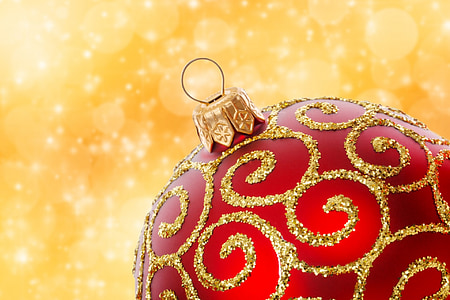 red and gold-colored Christmas Bauble