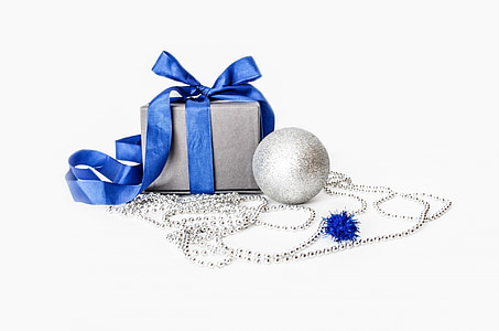 gray and blue gift box beside silver bauble