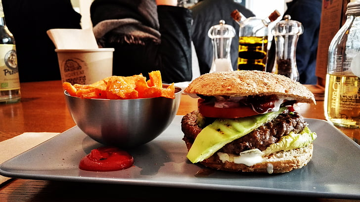 cooked burger with chip bowl