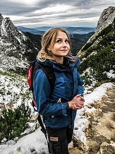 woman wearing blue and gray windbreaker jacket