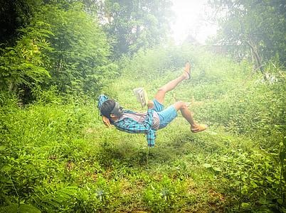 man doing stunt on green grass field