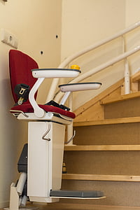 white and red stair lift chair