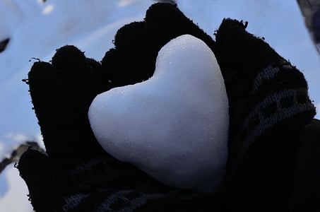heart snow on person's palms