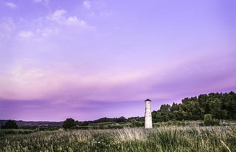 white lighthouse on green grass field