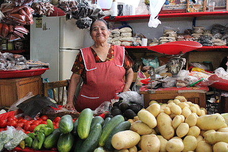woman wearing red dress standing in top of vegetables