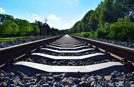 close-up photo of black train railways