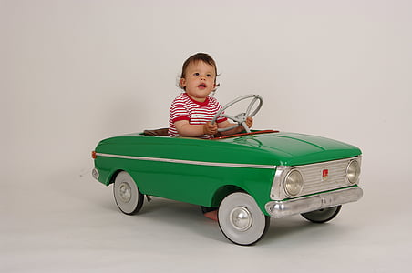baby riding green ride-on toy car
