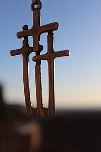 gold-colored triple cross pendant