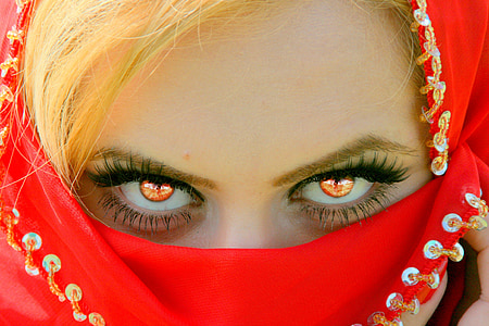 woman covering face with red textile