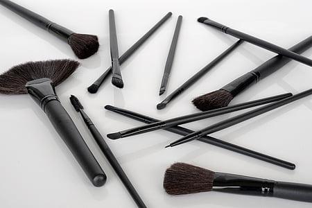 makeup brush set on white surface