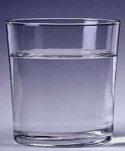 clear drinking glass filled with clear liquid
