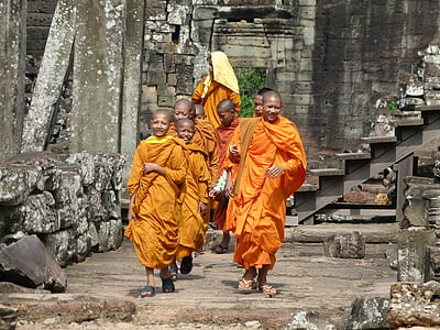group of monks walking along the bricks