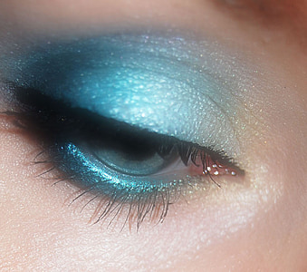 closeup photo of person's blue eyeshadow