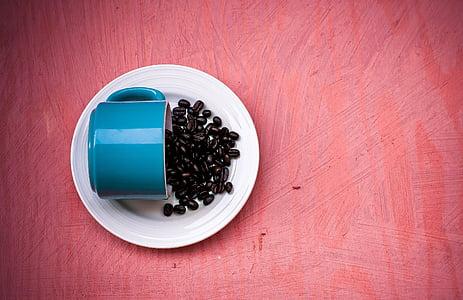 coffee bean serve on white saucer