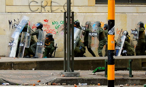policemen group near on concrete pavement