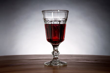 photo of clear wine glass with on table