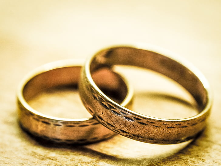 two silver-colored rings