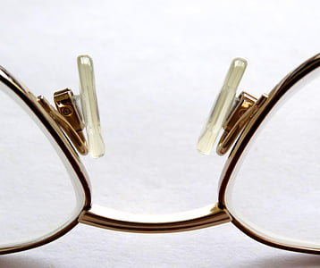 clear eyeglasses with gold frames