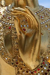 gold statue hand