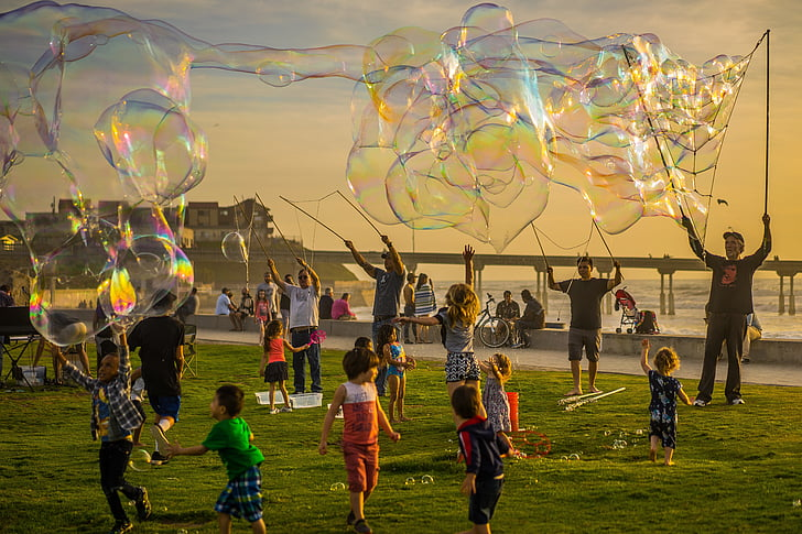 group of people playing with bubbles