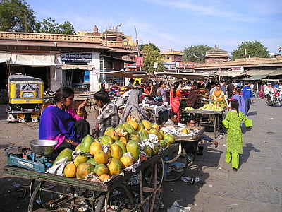 woman selling papayas during daytime