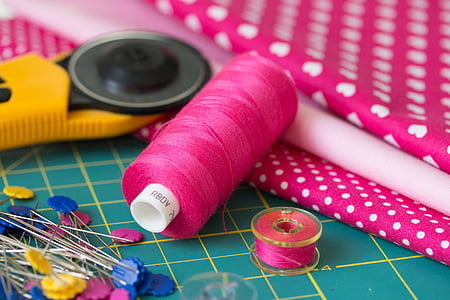 pink thread with needles