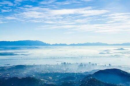 landscape photography of city with fog